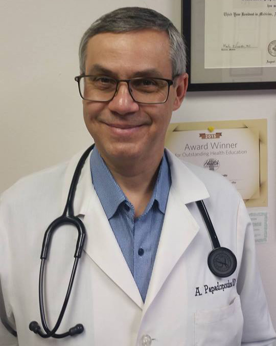 Doctor Antonios Papadopoulos in his office in Addison recently .