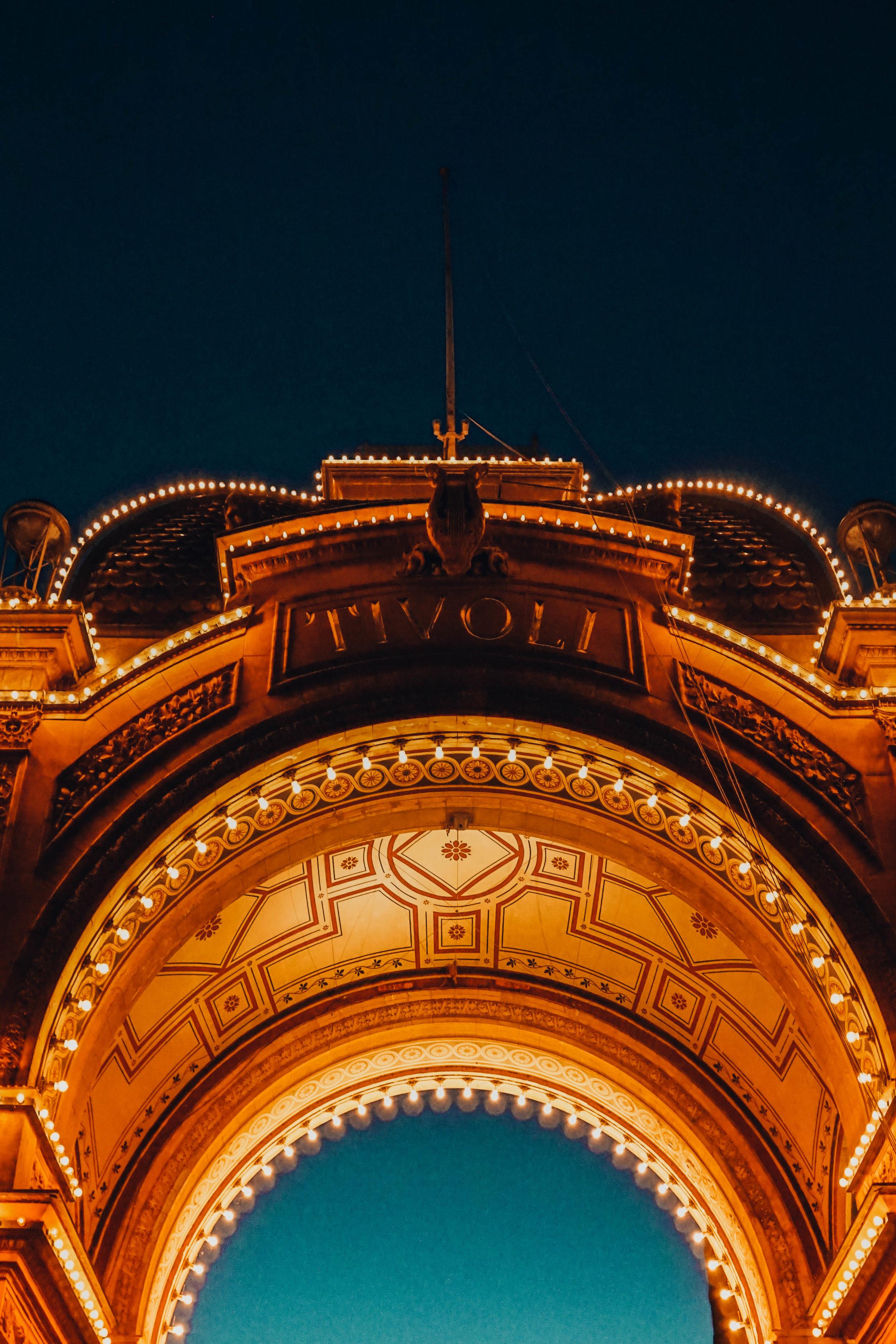 The archways to Tivoli at night.