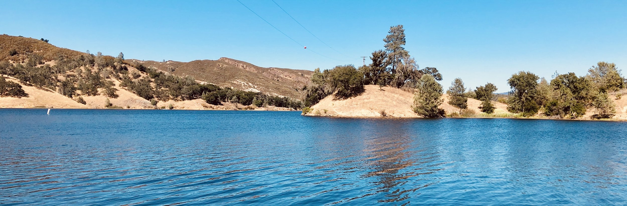 Santa Margarita Lake, with water that looks so refreshing you just want to jump in it…. But you can't. It's the drinking water reservoir for the city of San Luis Obispo. Such a tease.