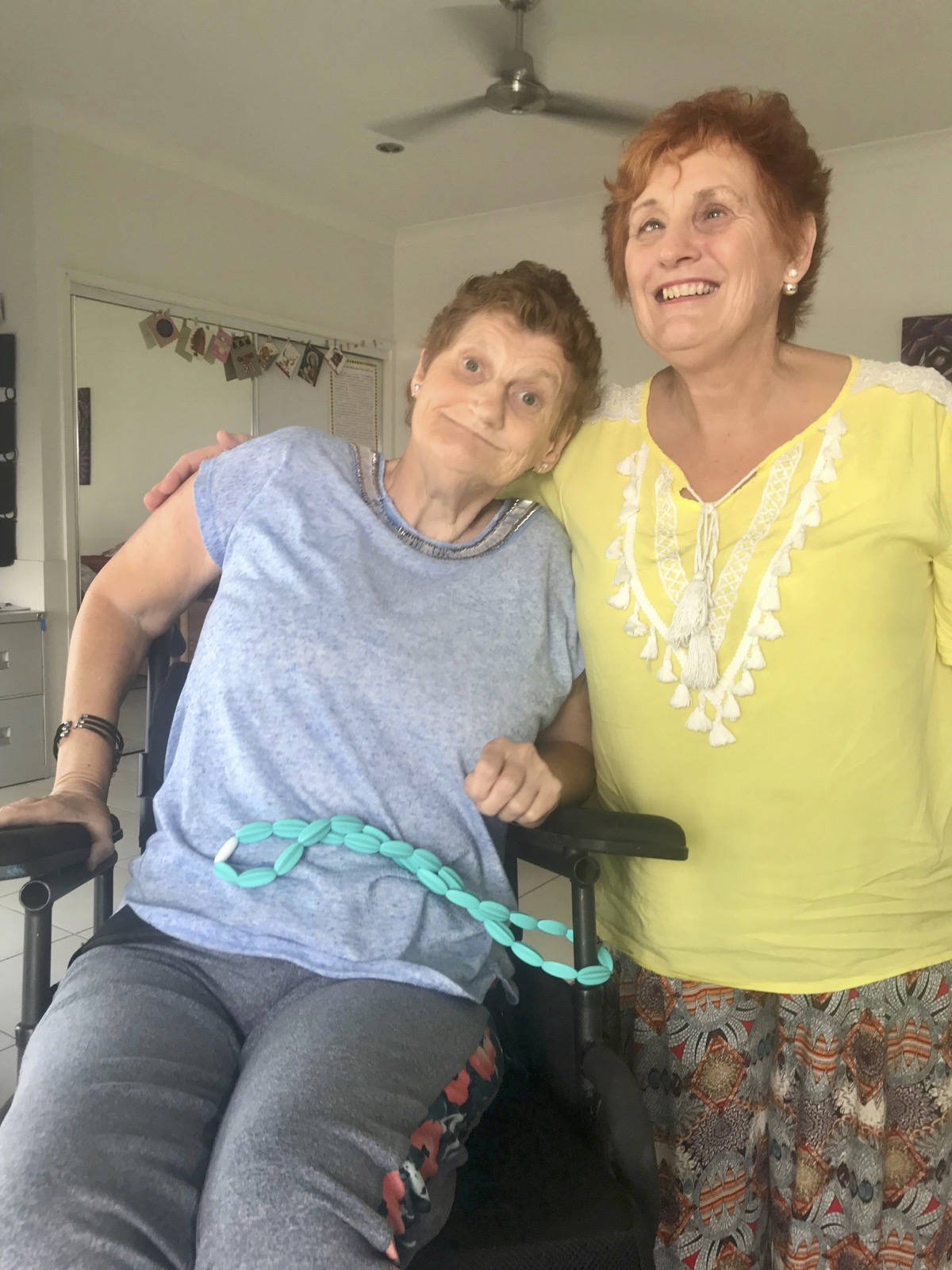 Cathy McMahon with her sister Cathy in her new home in Brisbane
