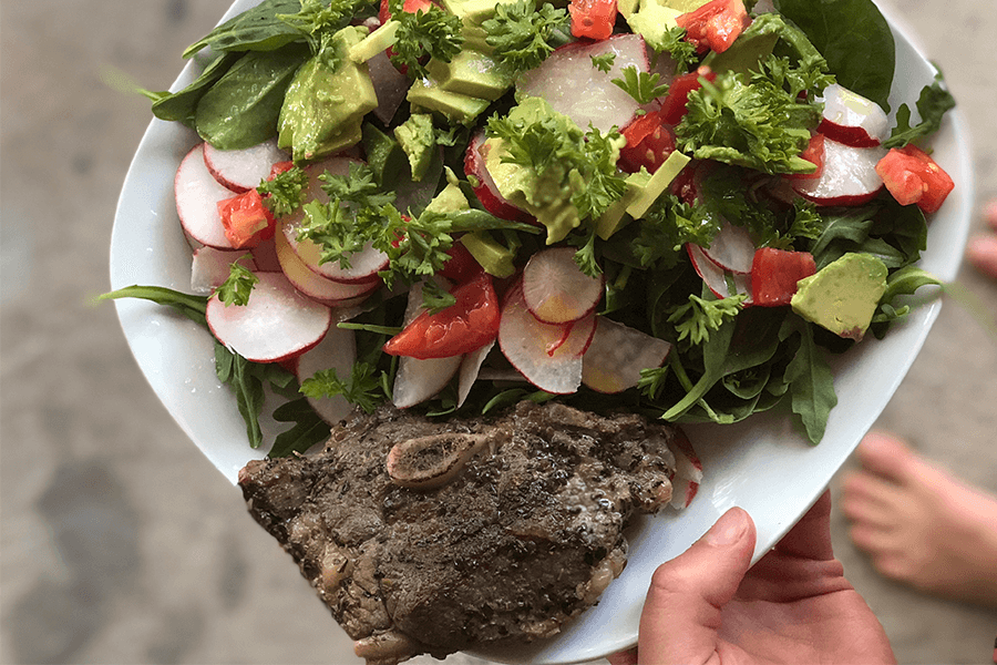 A typical meal for me—local grass-fed lamb with a huge, flavorful salad