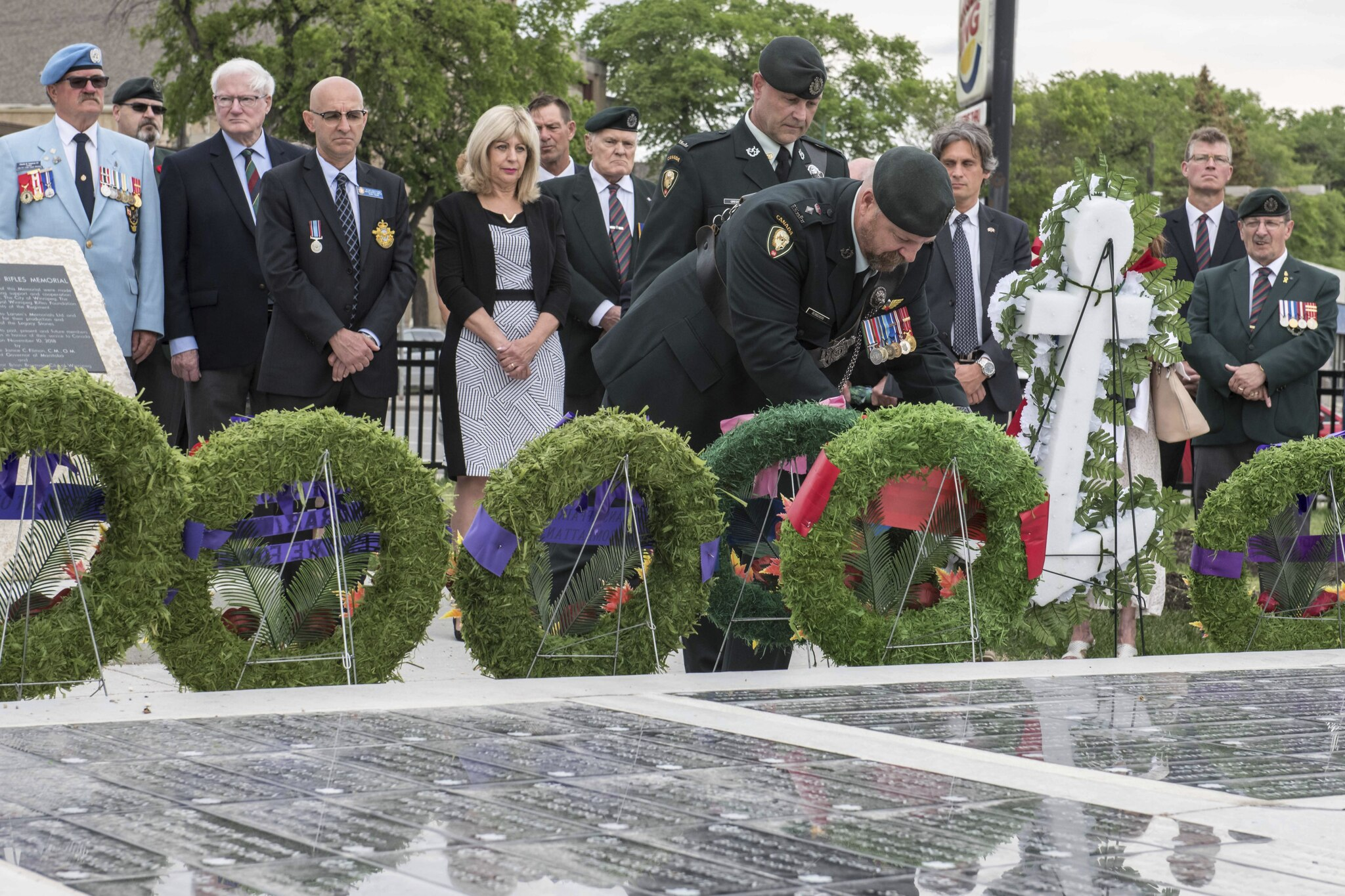 LCol Desrochers, Commanding Officer of the Rifles, laying a wreath; MWO Gregoire in the background.