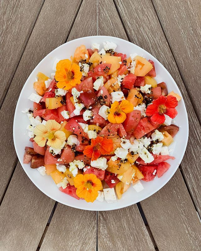 Heirloom tomato watermelon & feta salad with turmeric oil and topped with nasturtium flowers from the garden 🌺🌸🌼 recipe by @bonappetitmag