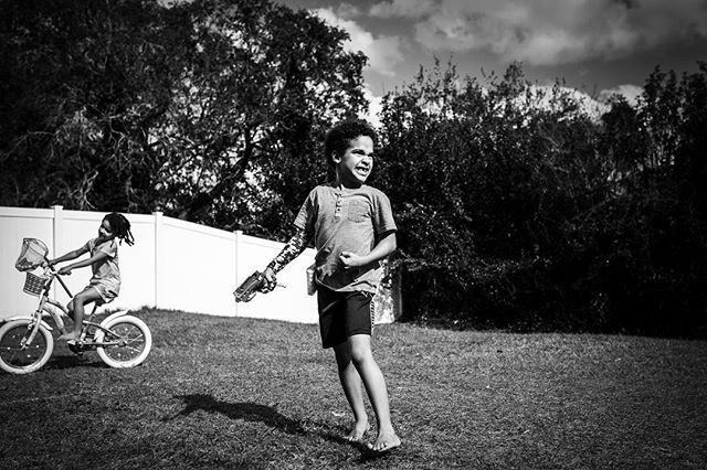 Victory is when you hit your brother in a Nerf war! • This year, I'm committed to documenting my own family in a more meaningful and consistent way. This is Day 1 of my #documentary365project! • • • • • #orlandofamilyphotographer #wintergardenfamilyphotographer #clermontfamilyphotographer #monochromaticlens #documentlife #documentaryphotographer #documentaryphotography #documentyourdays #snapfromtheheart #thesweetlife #thesweetlifeunscripted #shamoftheperfect #thebeautifulreal #dfpcommunity #childhoodunplugged #letthembelittle  #wildandbravelittles #magicofchildhood #runwildmychild #theartofchildhood #letthekids #letthemexplore #wildernesskids #kidswhoexplore #cultivatingchildren #kidsofthelens #lovelifeoutside #childofig #adventureswithchildren
