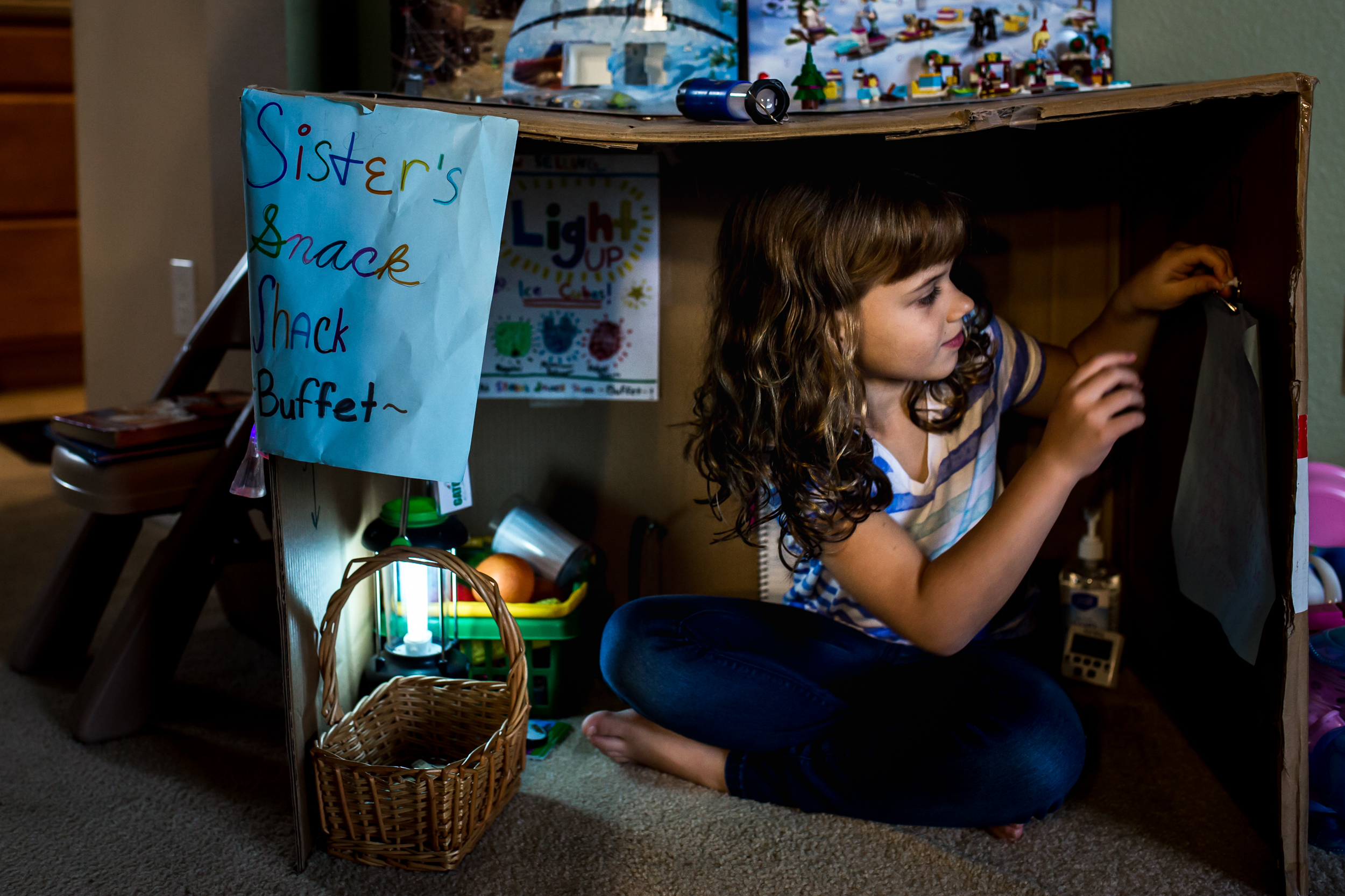 Girl plays pretend house during documentary family story session in Winter Garden, Florida.