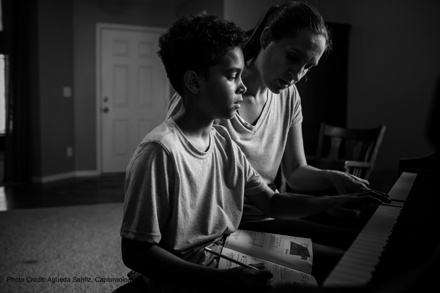 Mother teaches her son piano in Clermont, Florida