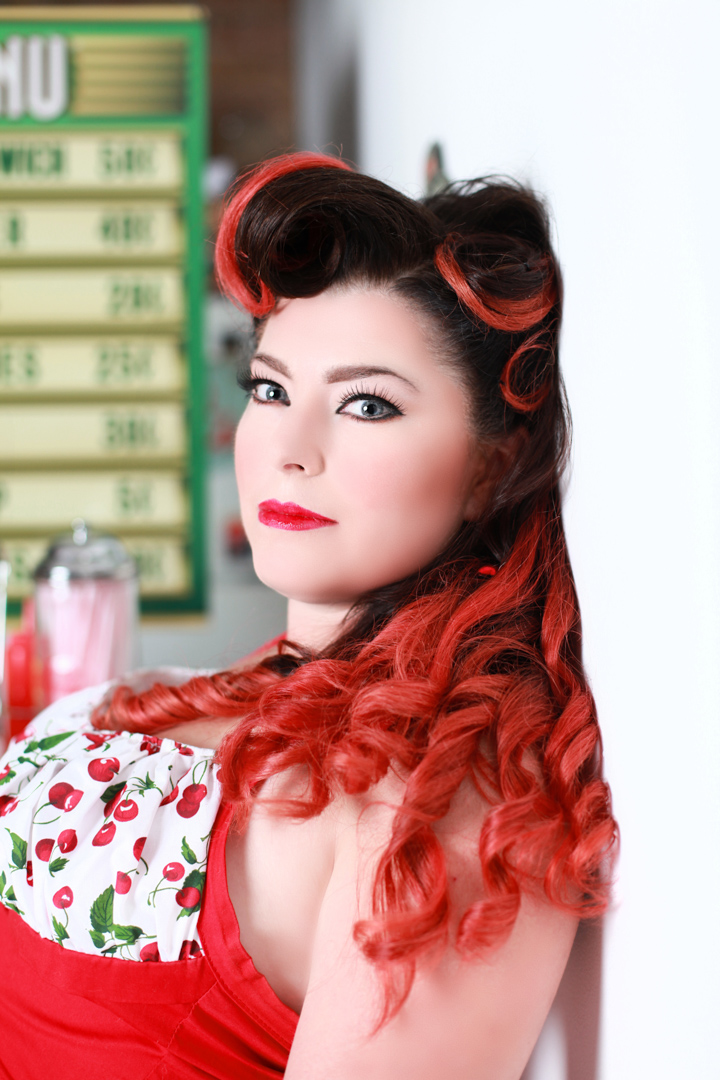 Chicago-Pinup-Photographer-Red-Hair-on-the-Diner-Wall