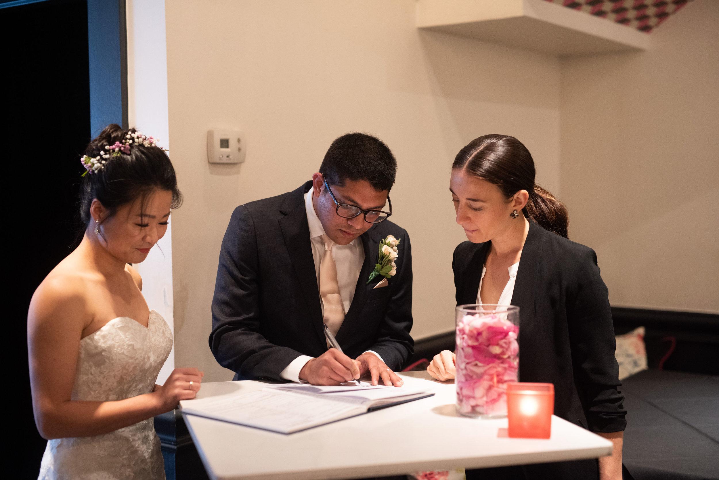 Pratish and Fei Signing.jpg