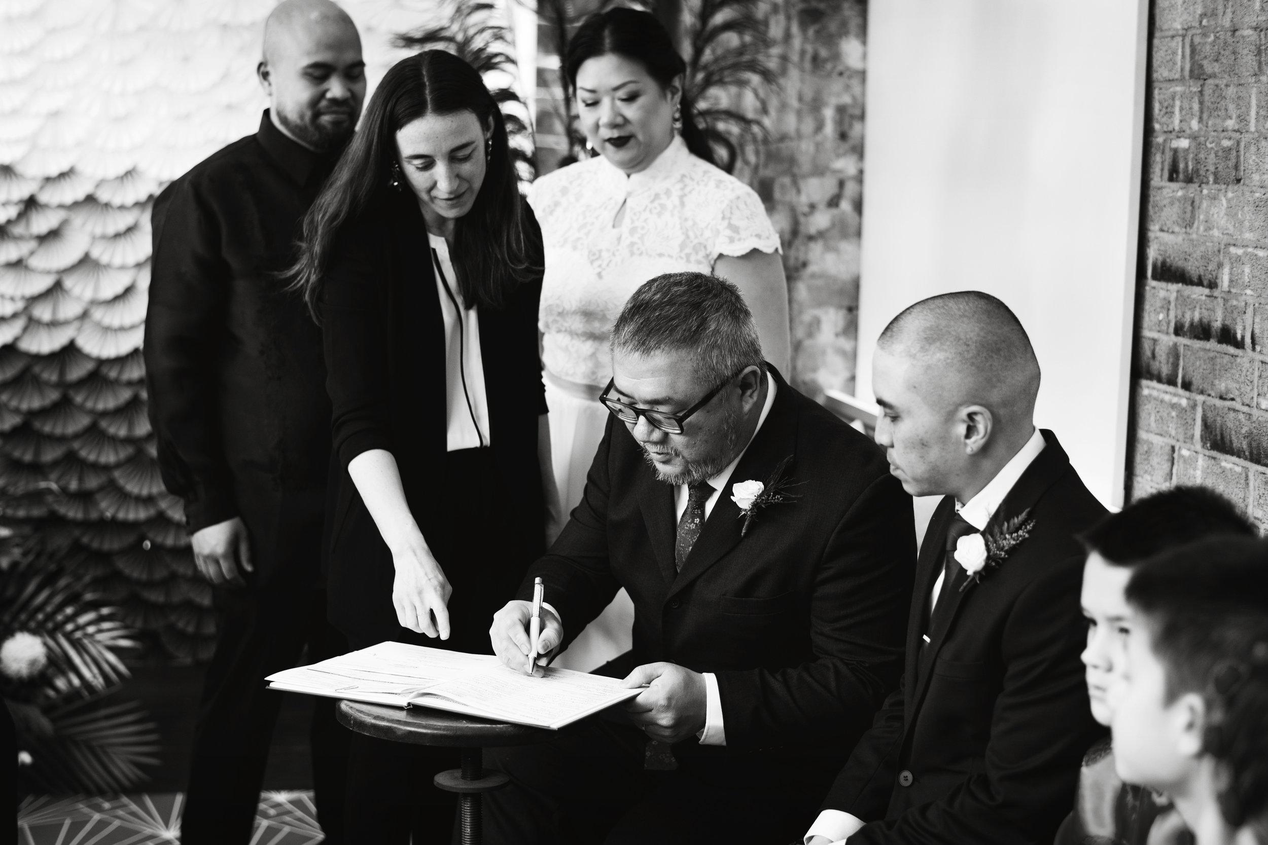 Lise and David bw signing.jpg