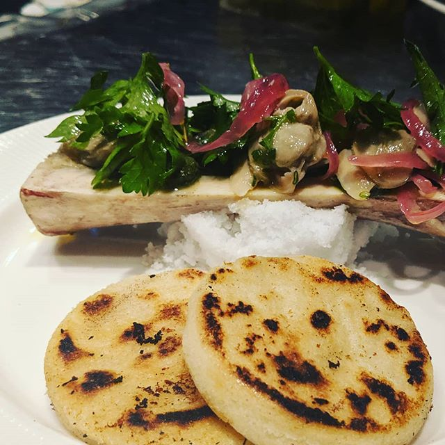 New on the menu...bone marrow, clams, arepas.  #bonemarrow #surfnturf #parsley #salad #arepa #columbia #butcher #provisions #provisions1142 #betterlightmakesbetterpictures #provisions1268isverydark