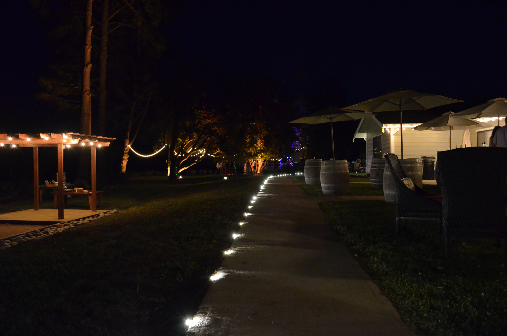 Nightime at Indian Creek Inn lit with strung lights keeps Anderson Valley weddings festive