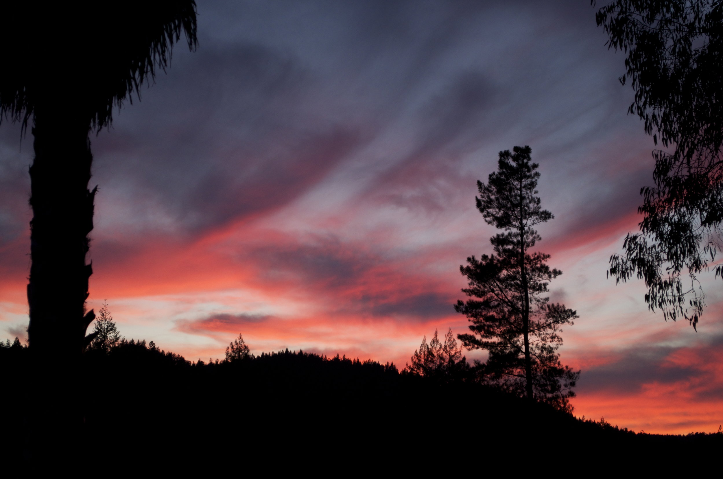 A view of the sunset over the hills of Anderson Valley from Indian Creek Inn