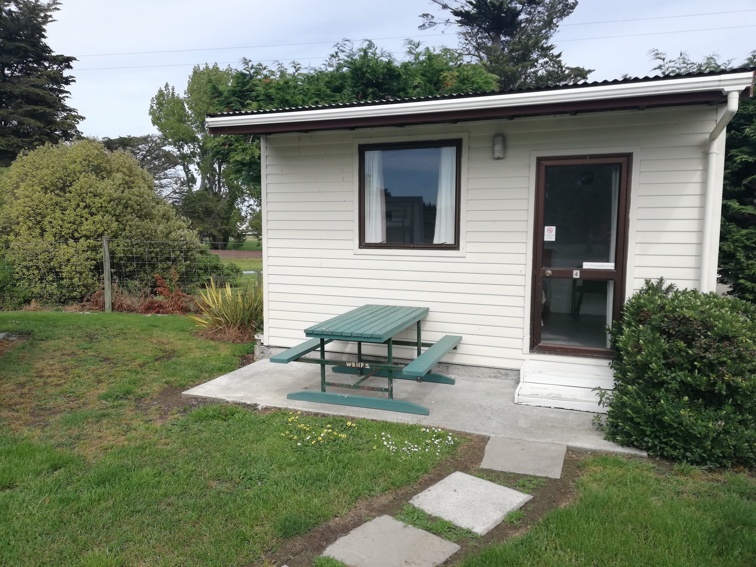 A small cabin with a fully made queen size bed and a set of bunks with the same facilities as our large cabin excluding a sink with running water.