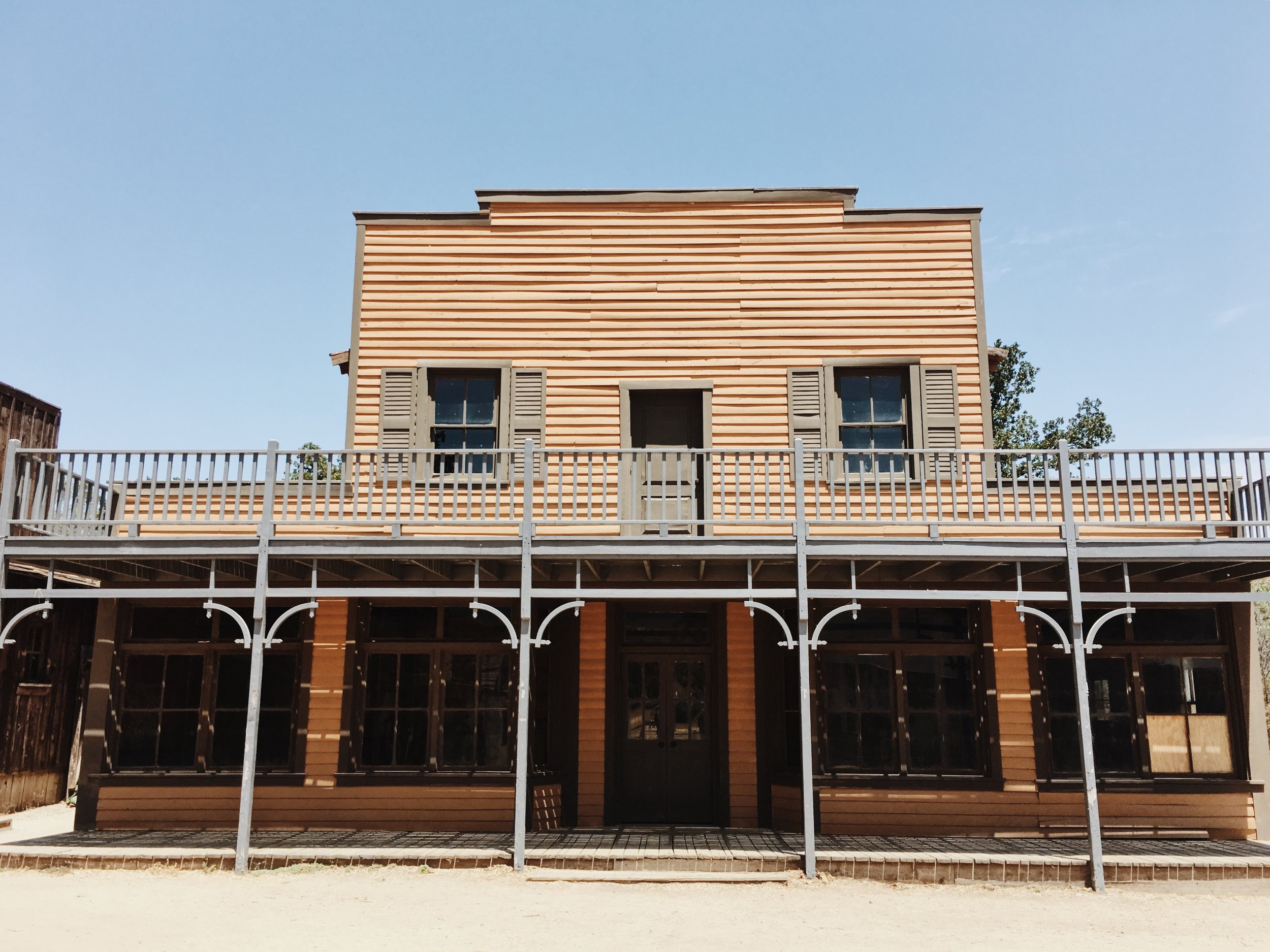 One of the best parts of Paramount Ranch is how photogenic it is, so make sure you come with camera in hand! We're going to talk you through a few of our favorite spots we took photos and the outfits we wore in each location. Lets do it!