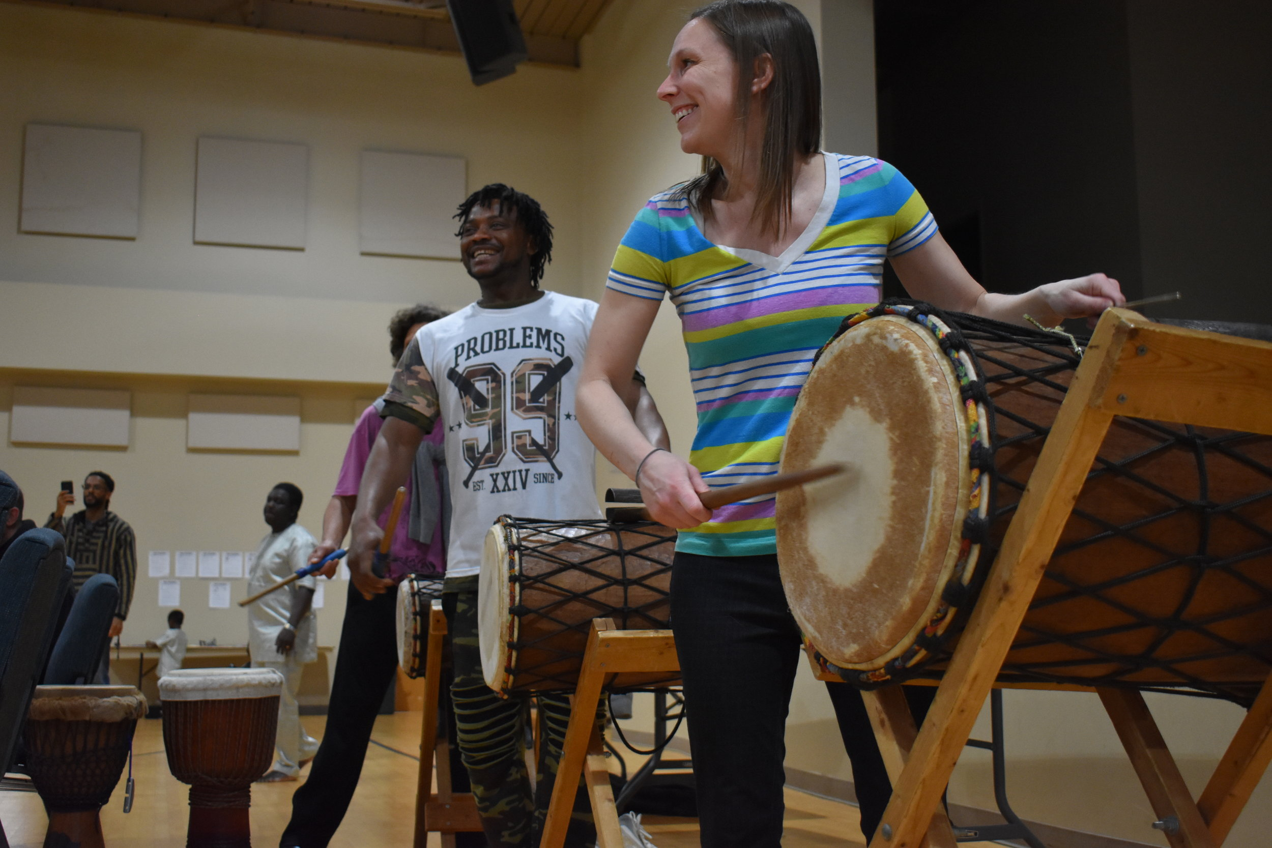 Senny Daffé (Conakry, Guinea) teaches dundun drums to MU professor Dr. Megan Arns and Columbia community members