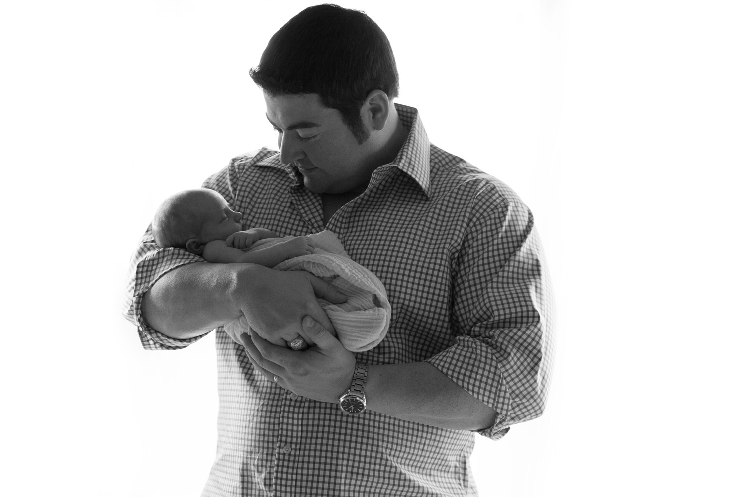 father_holding_newborn_black_and_white.jpg