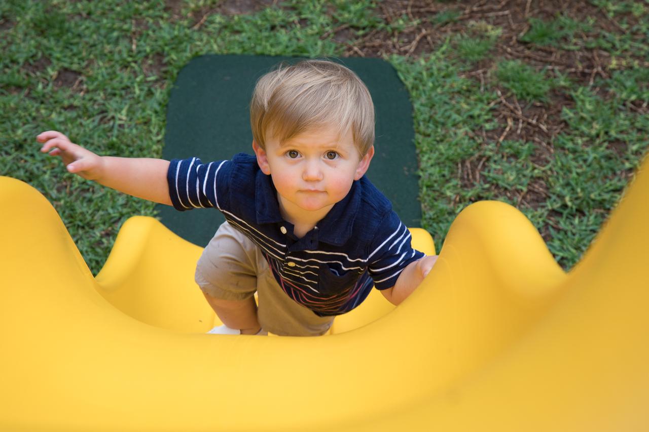 houston family lifestyle photography boy climbing slide
