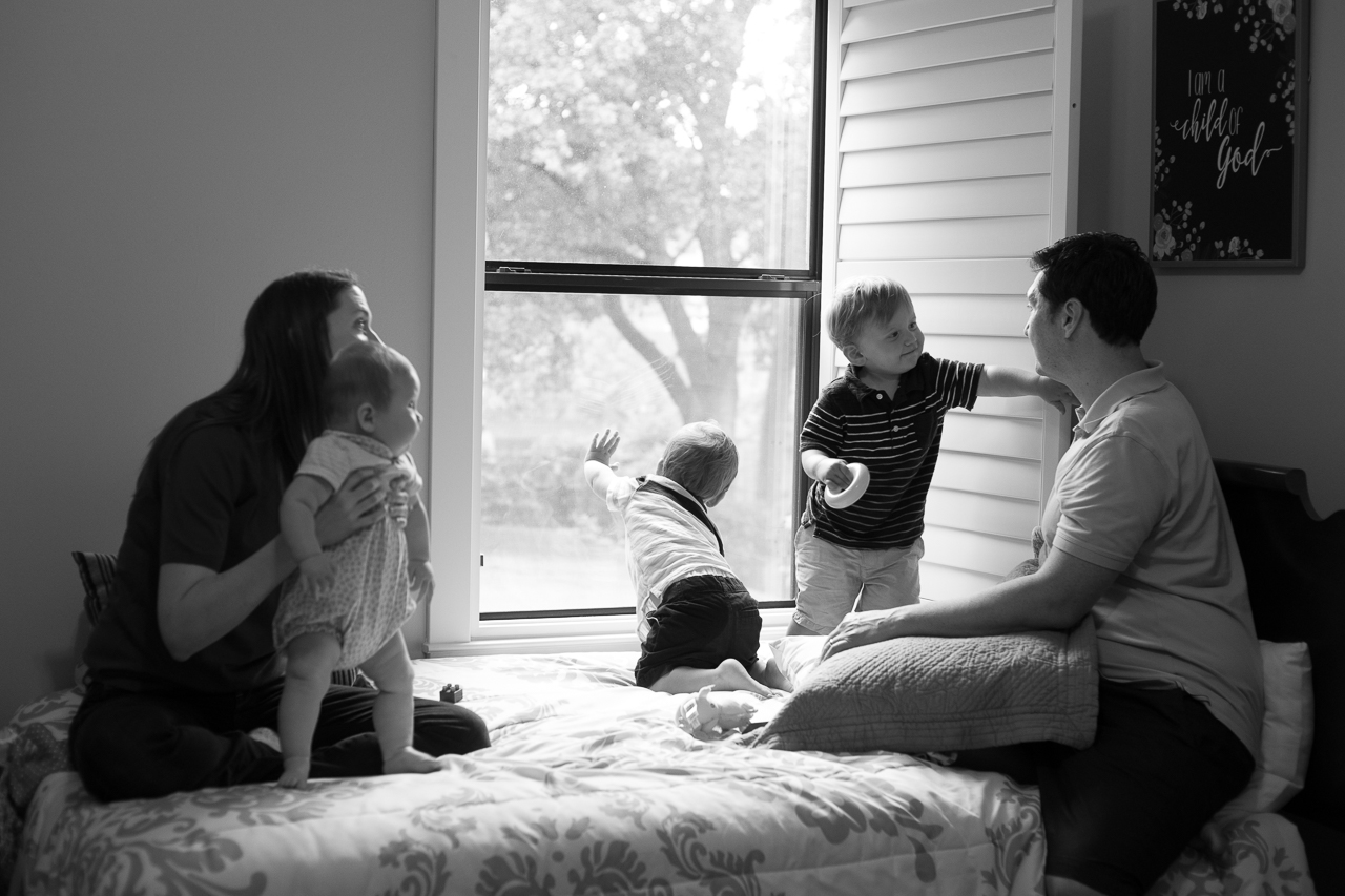 houston lifestyle family photographer family chilling on bed