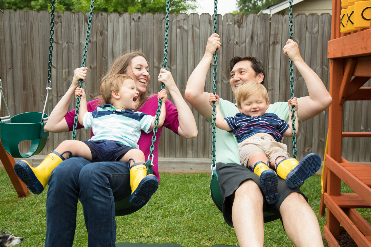 houston family documentary photography parents and twins swinging