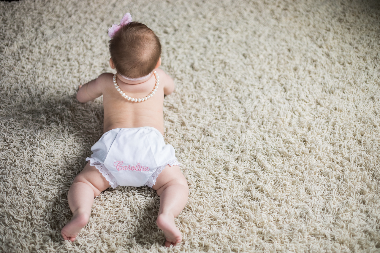 baby crawling during home photo session