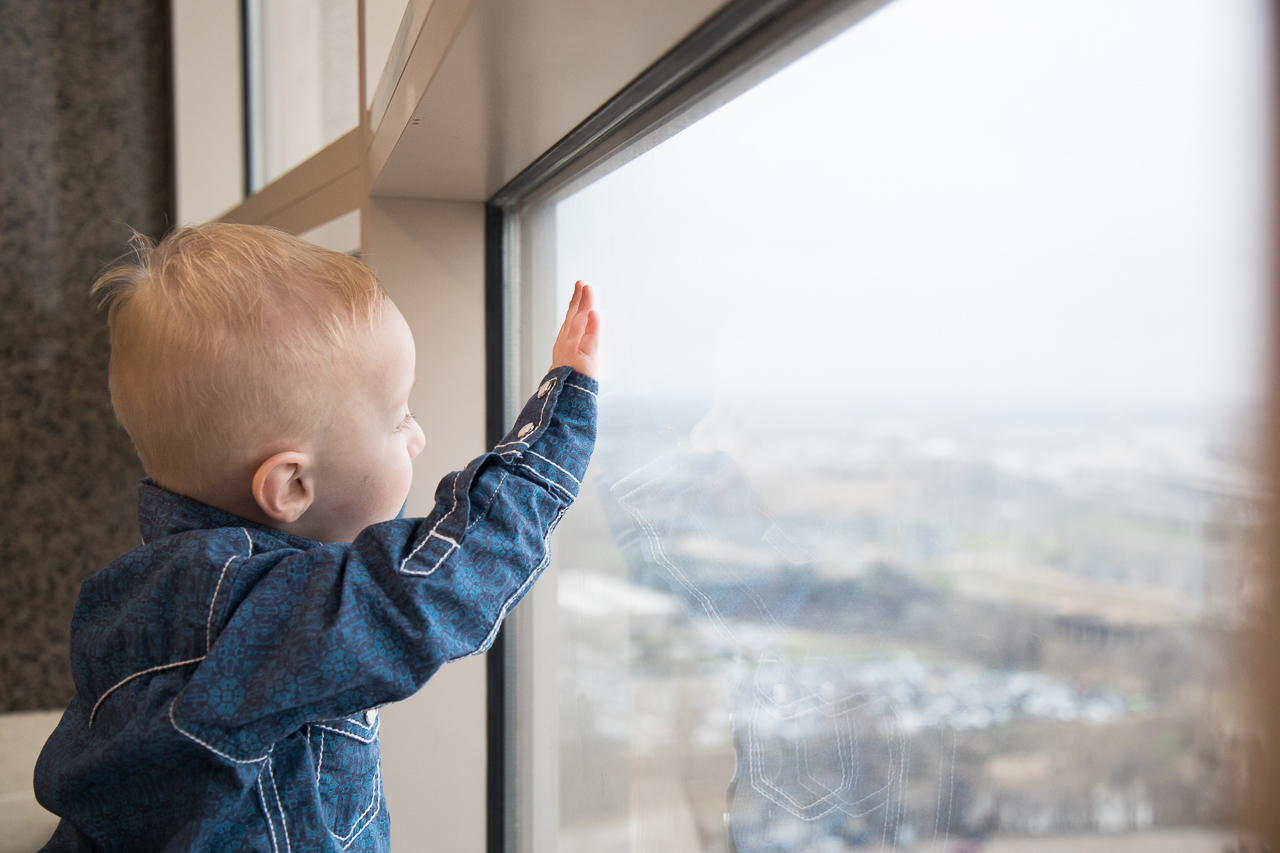 houston adoption photography little boy looking out courthouse window