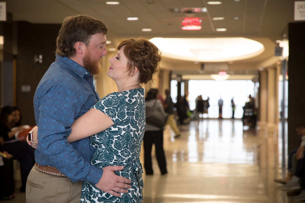 houston adoptive parents hug outside courtroom while waiting for adoption proceeding