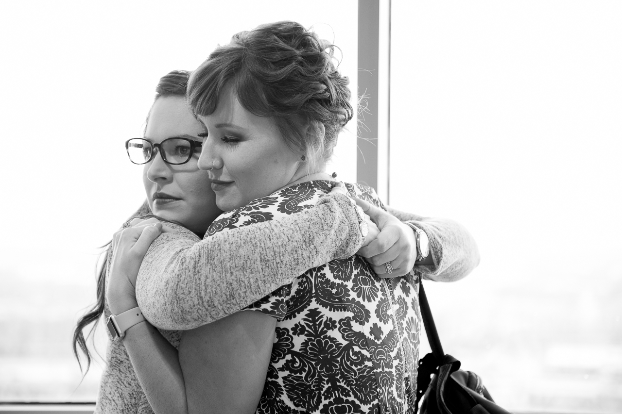 adoption day photography mother embraces sister outside courtroom