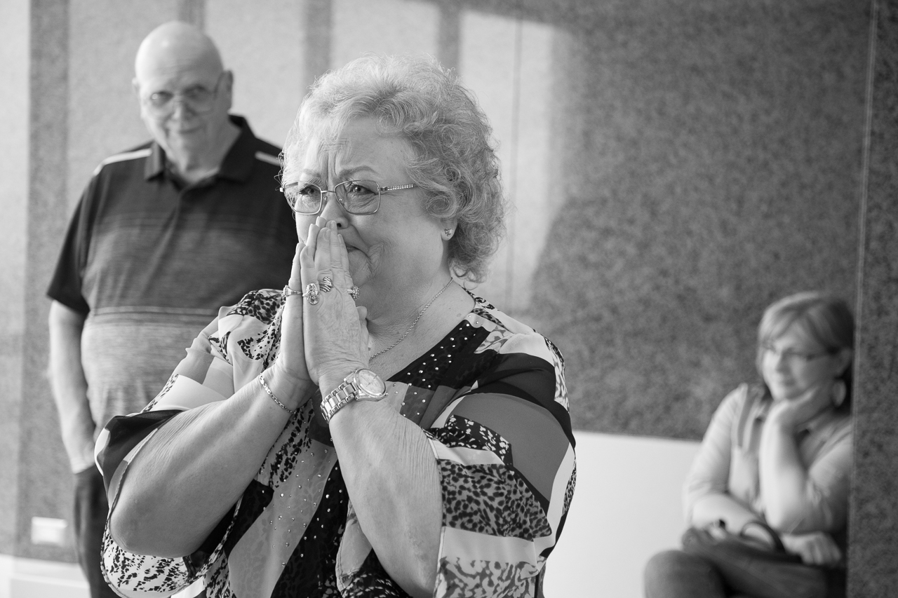 adoption day photography grandma crying tears of joy grandpa looking on