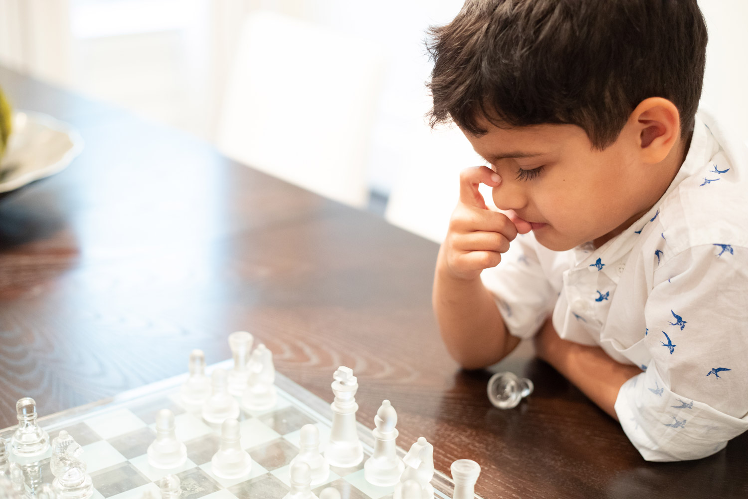 houston-family-lifestyle-photography-son-contemplating-chess-move.jpg