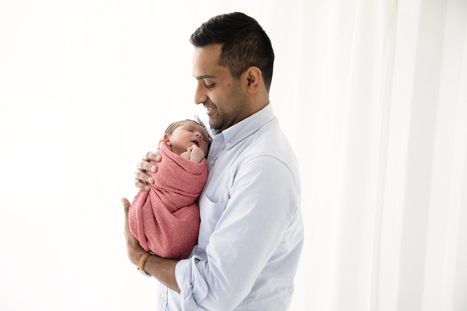 houston newborn photography father holding baby girl
