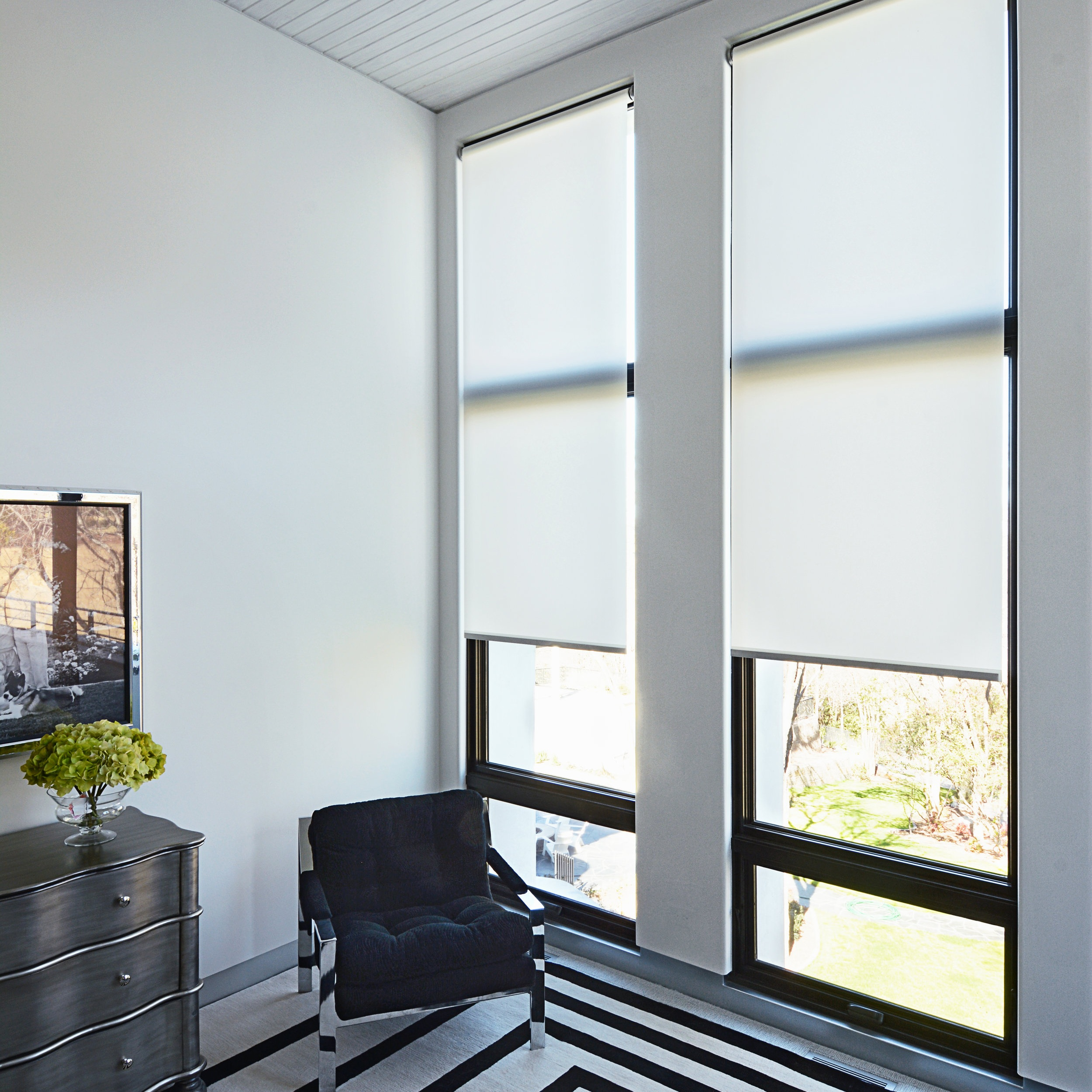 Translucent fabric obscures visibility. This option is suitable for spaces that require ambient lighting, UV protection, and privacy. -