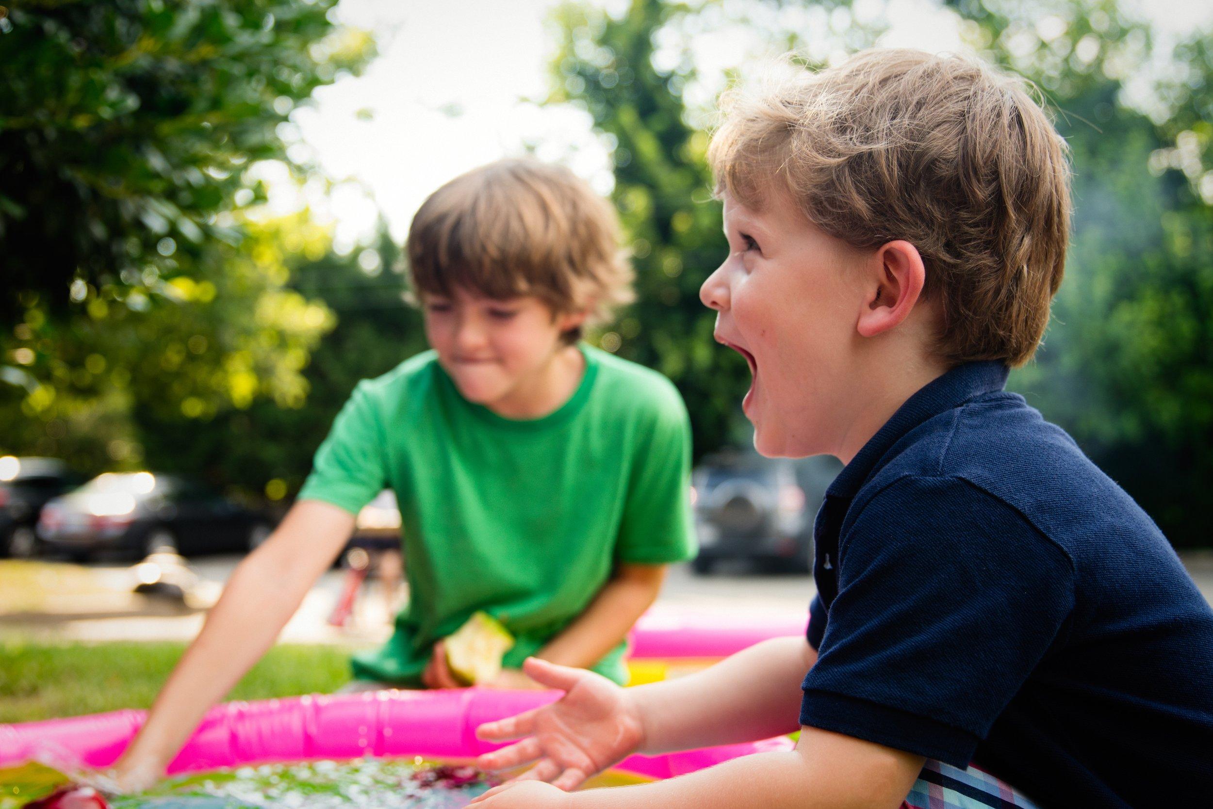 children boys laughing outside