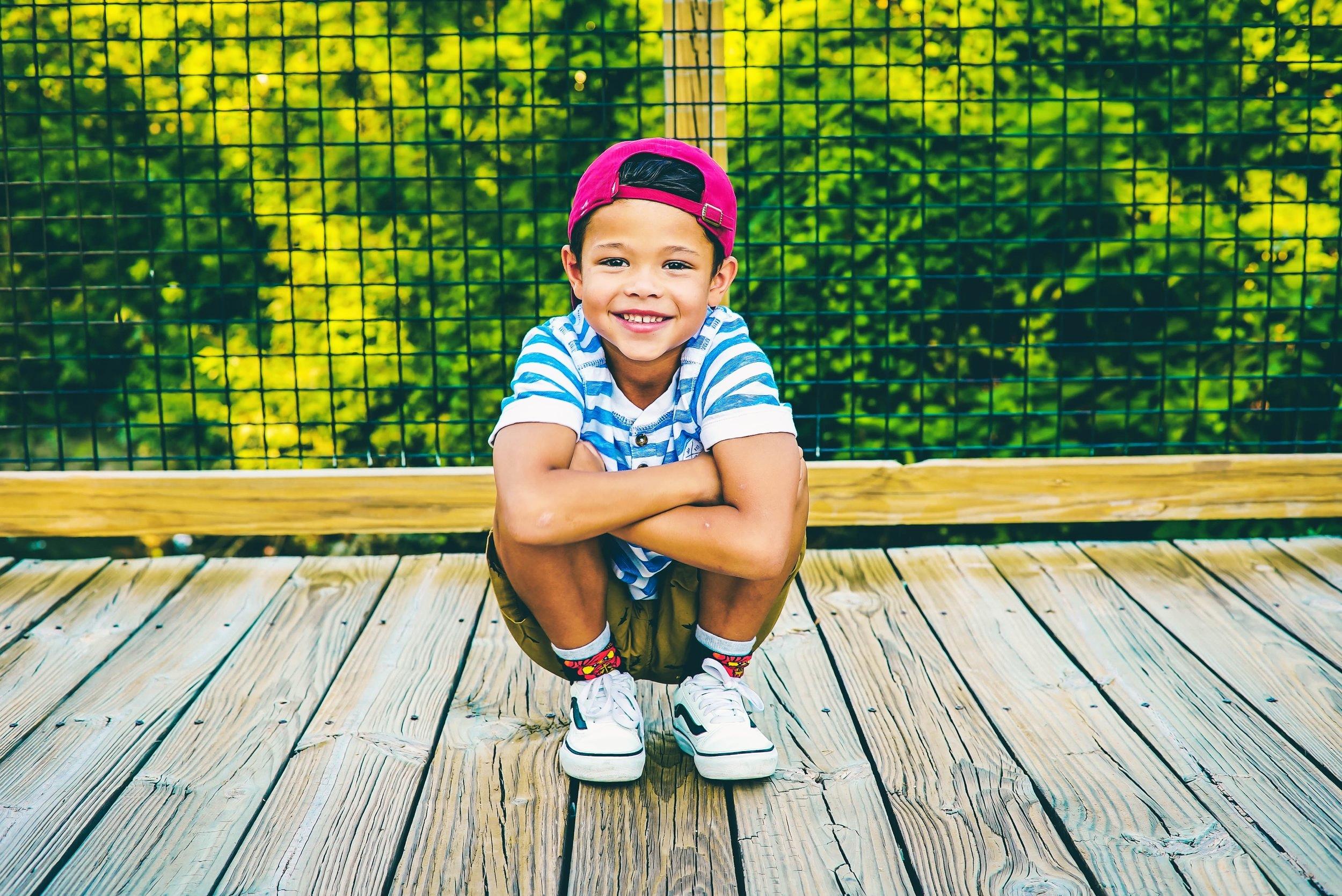 Child boy outside smiling decking