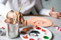 Child making art with paints
