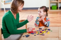 Speech therapist working with child articulation therapy