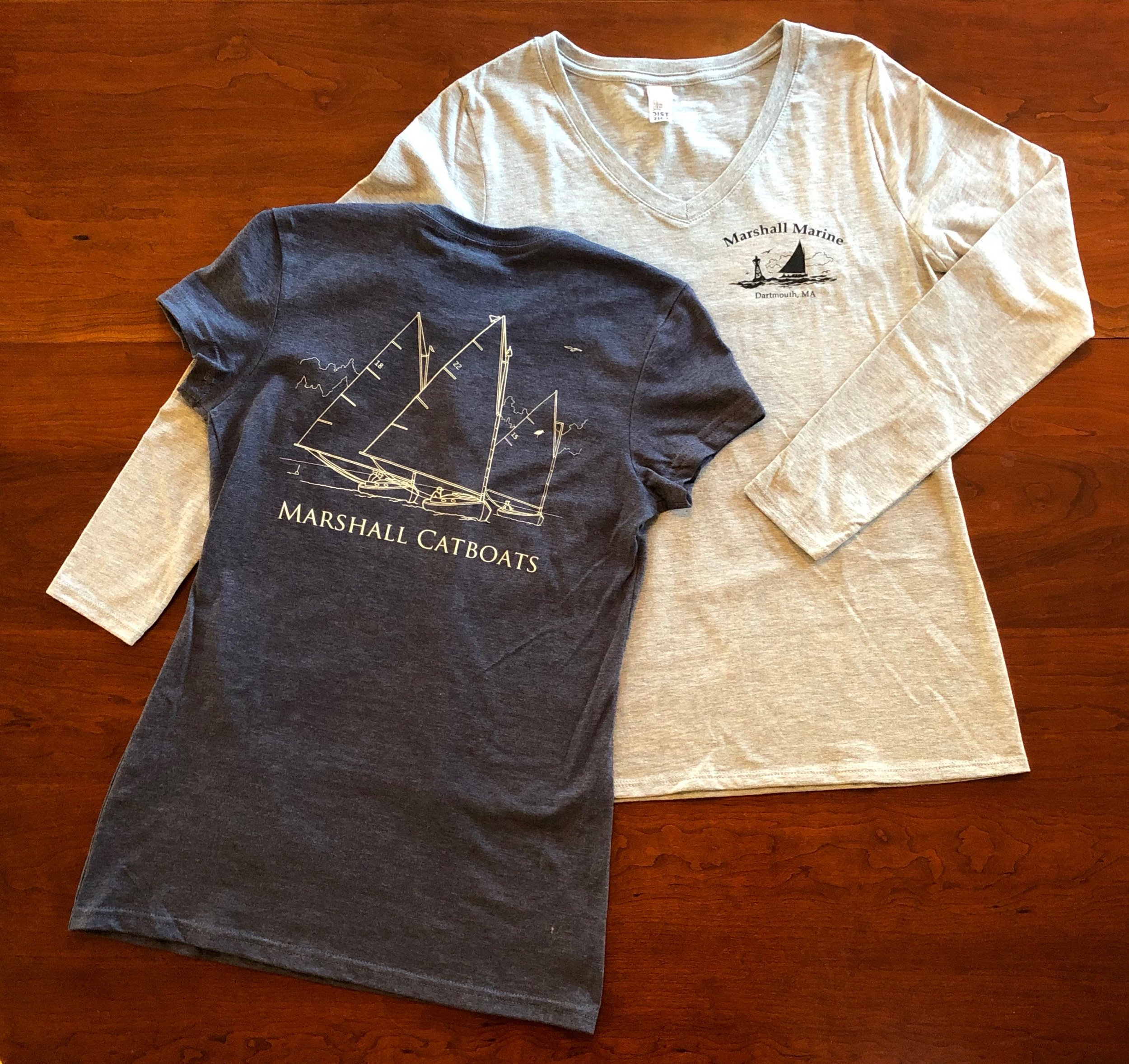 "Women's T Shirts - District ""Very Important Tees""Short sleeve crew neck in heathered blue4.3 oz. 50/50 ring spun combed cotton/poly; sizing runs small, order size up unless you like them very ""fitted.""XS - 2XL $15.00Long sleeve V-neck in light heathered grey4.3 oz 90/10 ring spun combed cotton/poly; true to sizeSmall - XL $20.00"