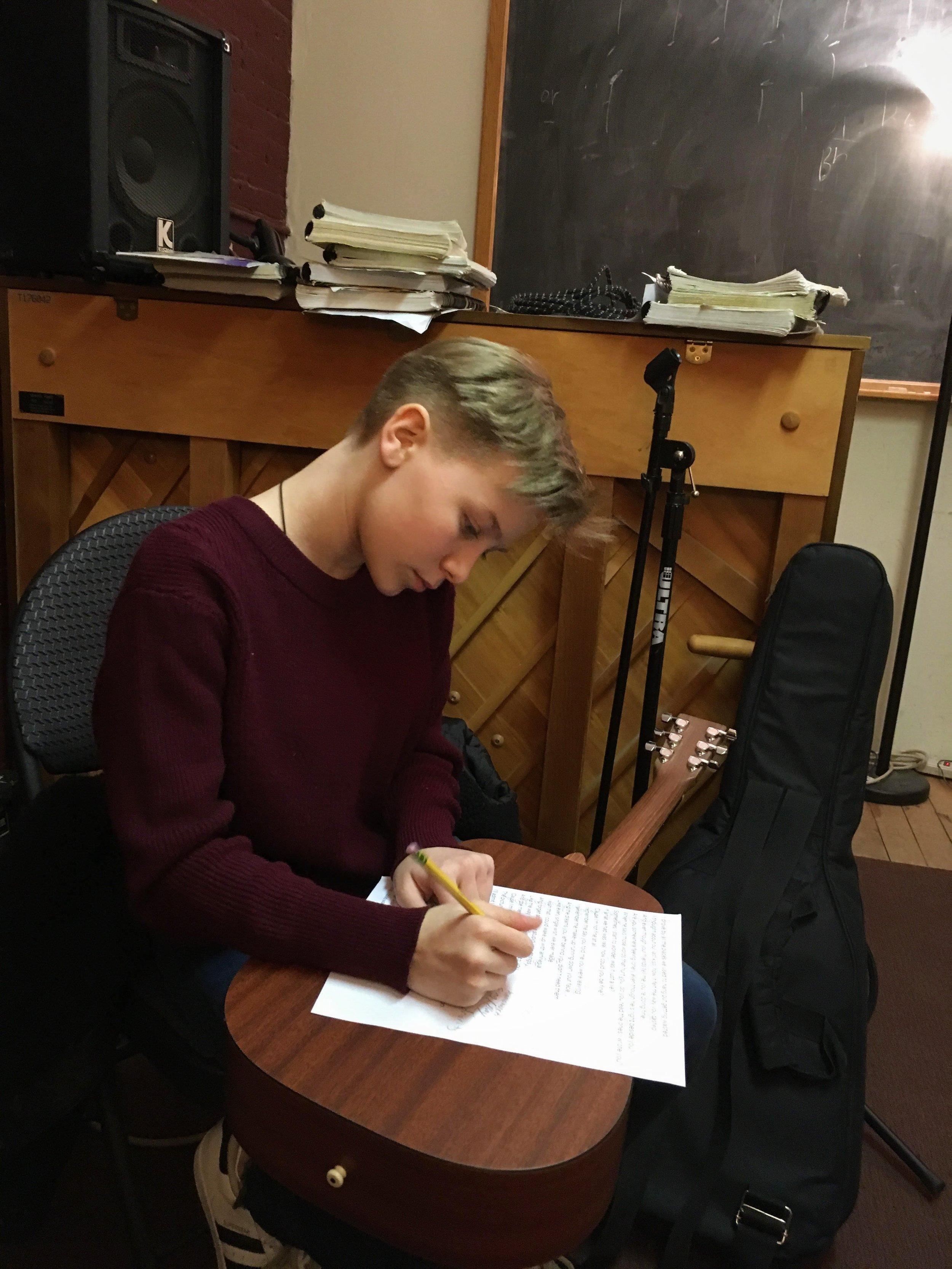 guitar writing kid.jpg