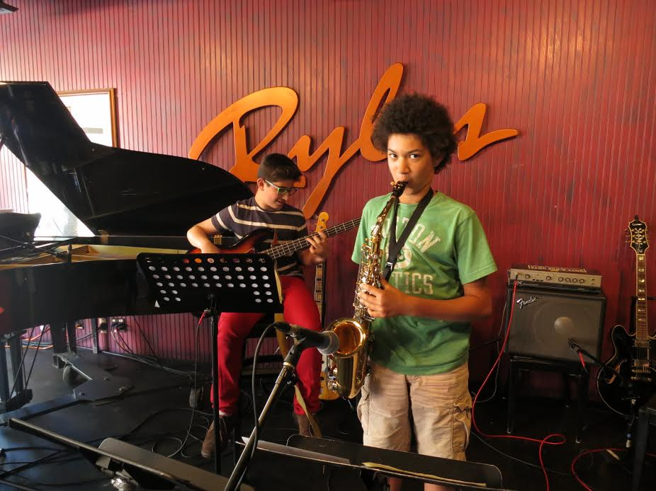 YOUTH JAZZ ENSEMBLES - Our Youth Ensemble program is designed to inspire our students to become comfortable improvising musicians. To insure that our students have a valuable and enjoyable experience, they are placed in ensembles based on age and experience level. Players who have never improvised before are placed with others who are also beginners, while more experienced students are placed in groups that will give them the challenges they need to grow as far as possible. Our ensembles perform three times a year for friends and family. A professional recording is made of each of performances and are made available to listen to, share, and enjoy.At every level, our students are given the expert guidance they need to play together as a team, and to express themselves as a soloist. Regardless of their current abilities, our students are encouraged to grow in a relaxed and fun atmosphere.
