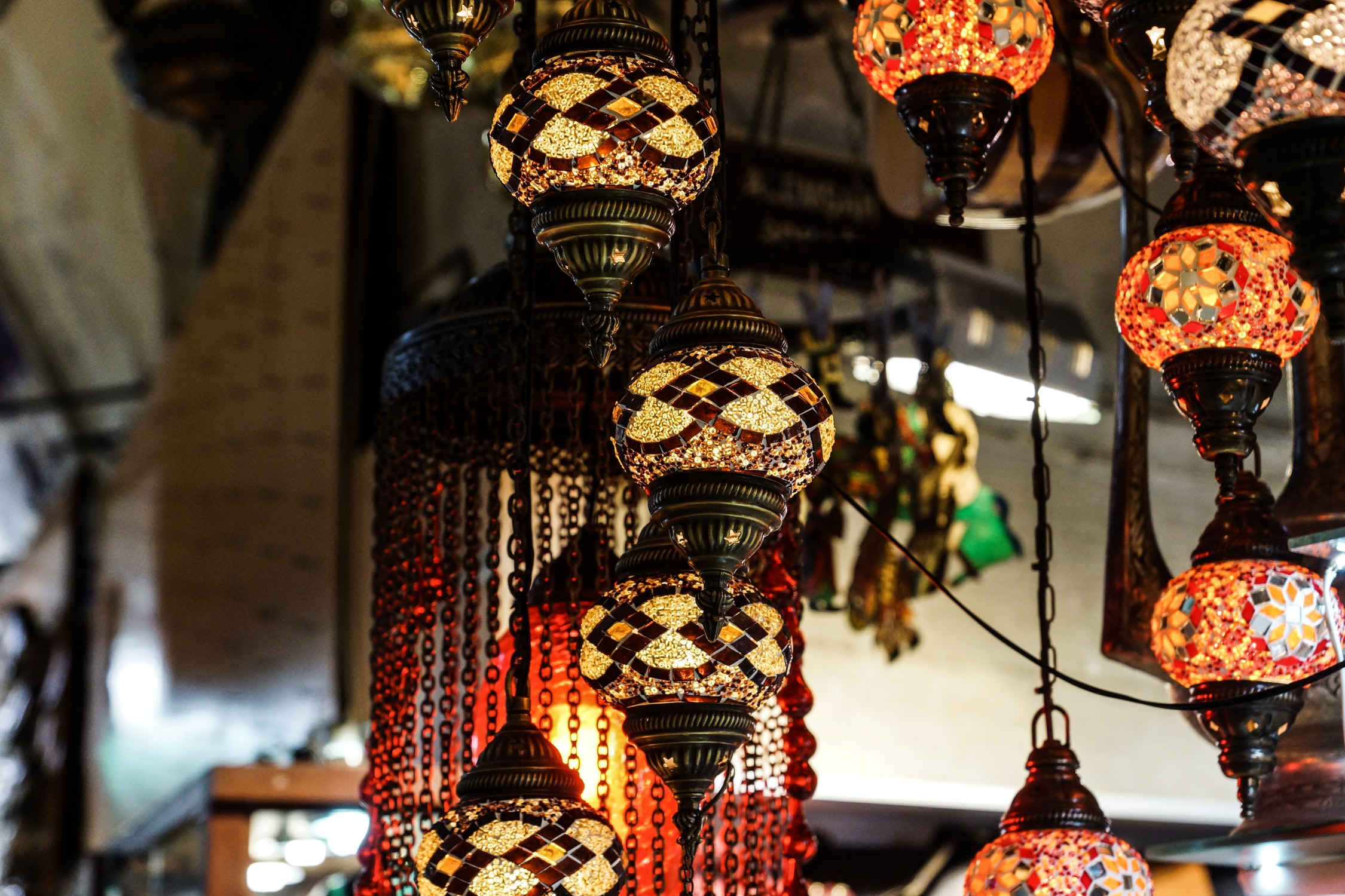 Beautiful stained glass lanterns hanging in a Turkish bazaar.