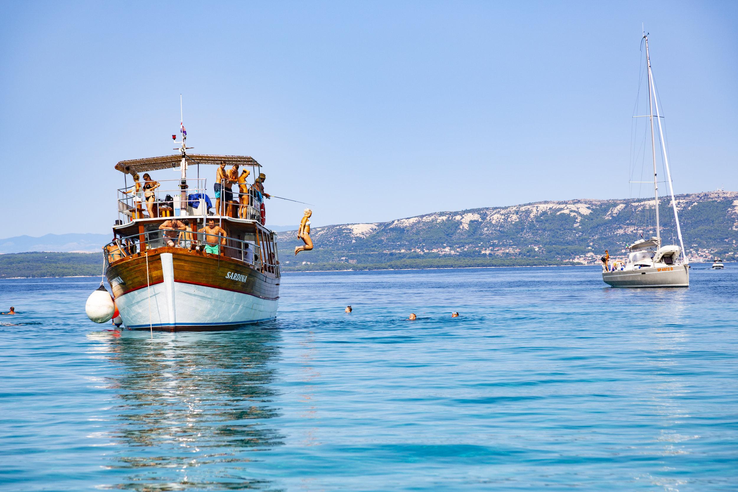 Swim & play in the warm Adriatic Sea at Dolfin Island
