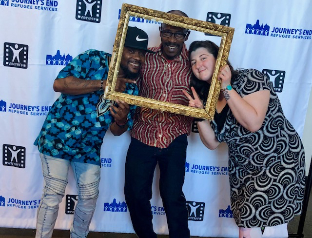 JERS volunteer teaching artist (and designer of our fabulous new marketing materials for the 2nd Annual WNY Refugee Film Festival) Ruby Merritt poses on red carpet with our awesome entertainers at our Global VIP Reception, African drummer extraordinaire Mohamed Diaby (m) and phenomenal choreographer & dancer Eric Ansuade, who, along with drummer Griffin James Brady, got all of us dancing with their performance!