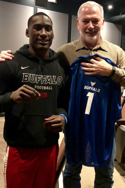 UB Bulls star running back Kevin Marks stopped by to donate a door prize of a Bulls jersey!