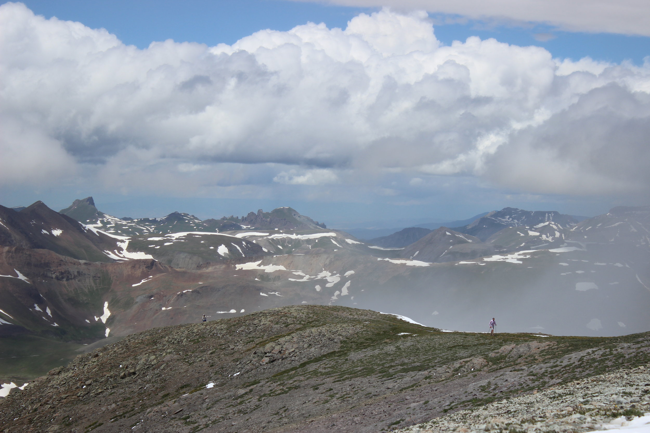 A runner comes over handie's peak, a 14,000+ft peak on the hardrock 100 mile course.