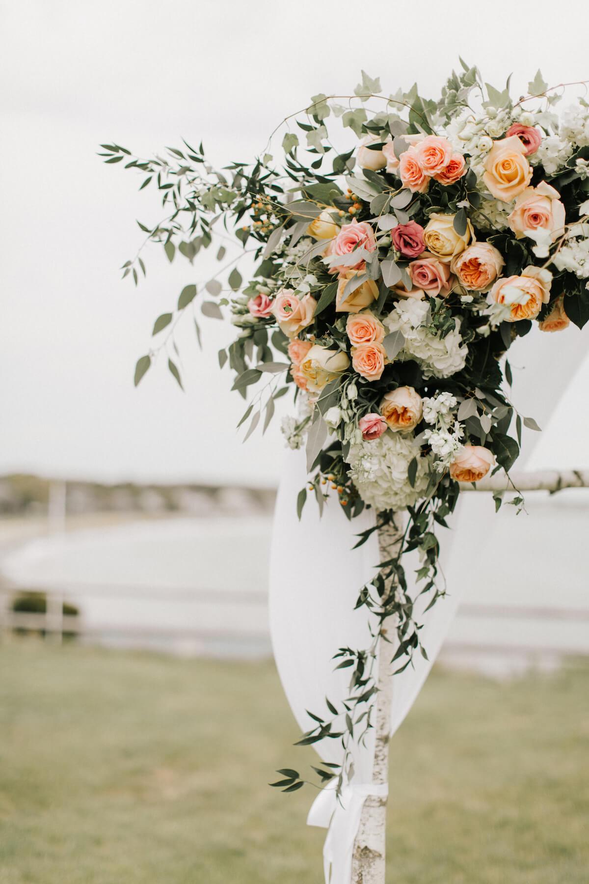 floral-arbor-wedding-ceremony-pastel-roses.jpg