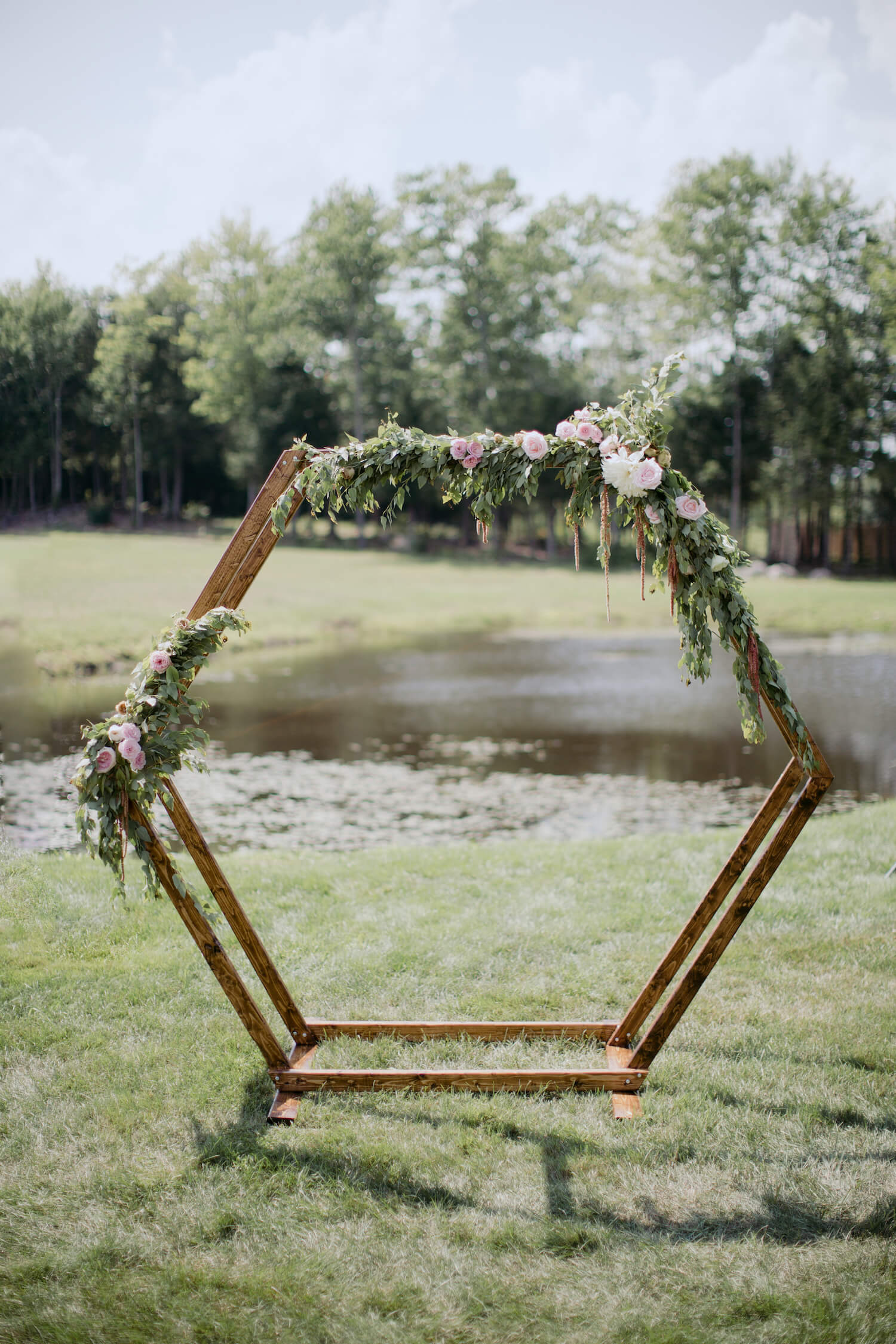 wooden-wedding-arbor-florals.jpg