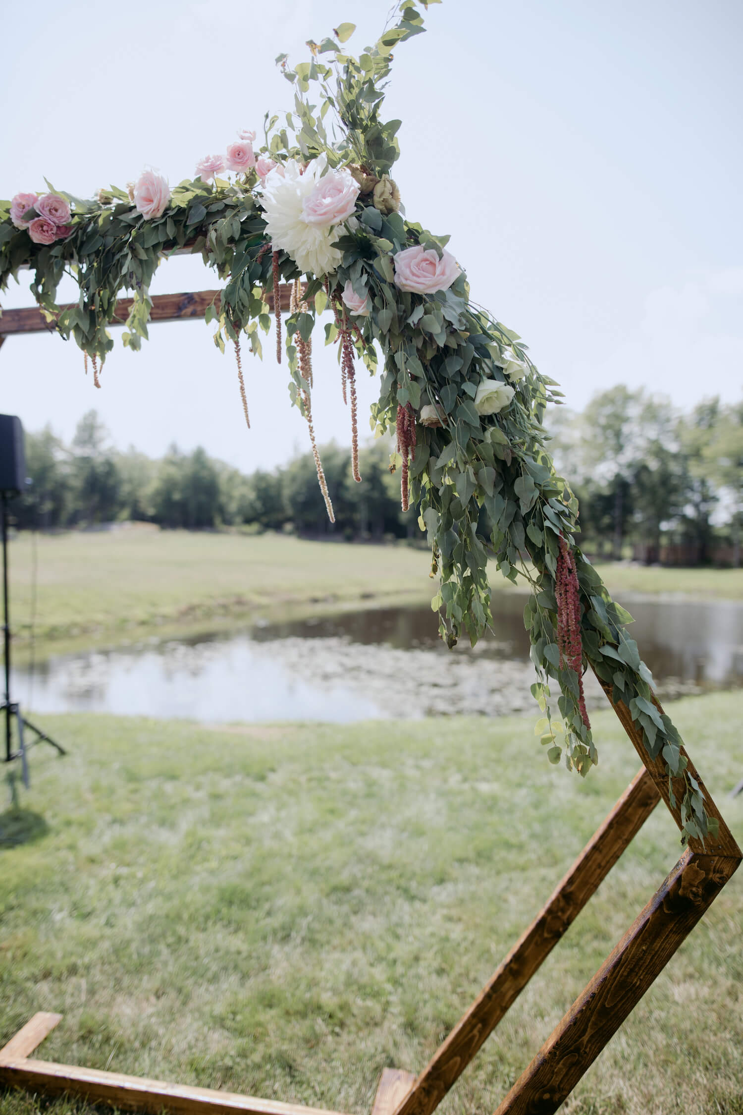 wooden-wedding-arbor-greenery-flowers.jpg