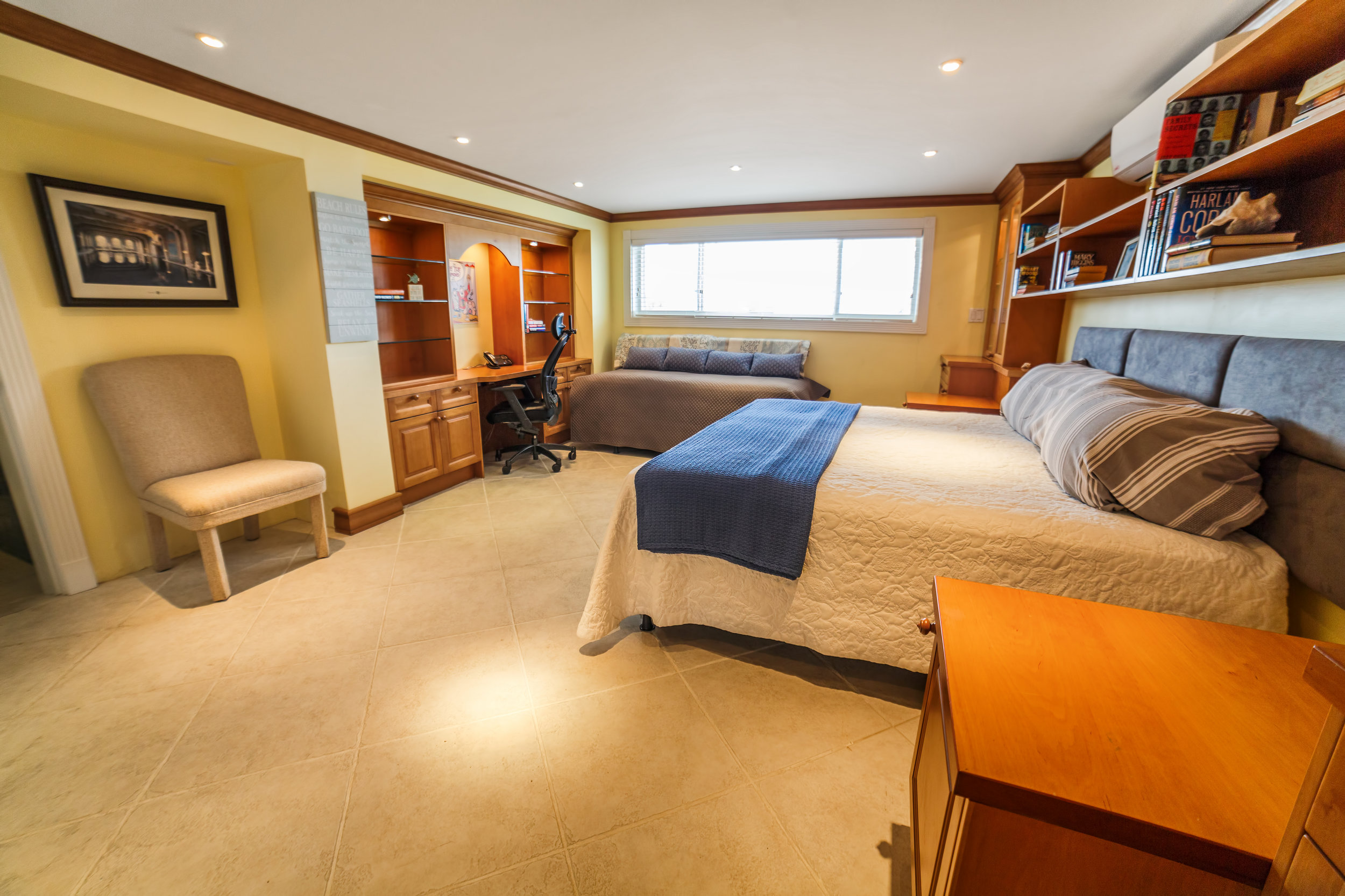 This bedroom features a king bed plus a day bed that can convert into three twins for extra people