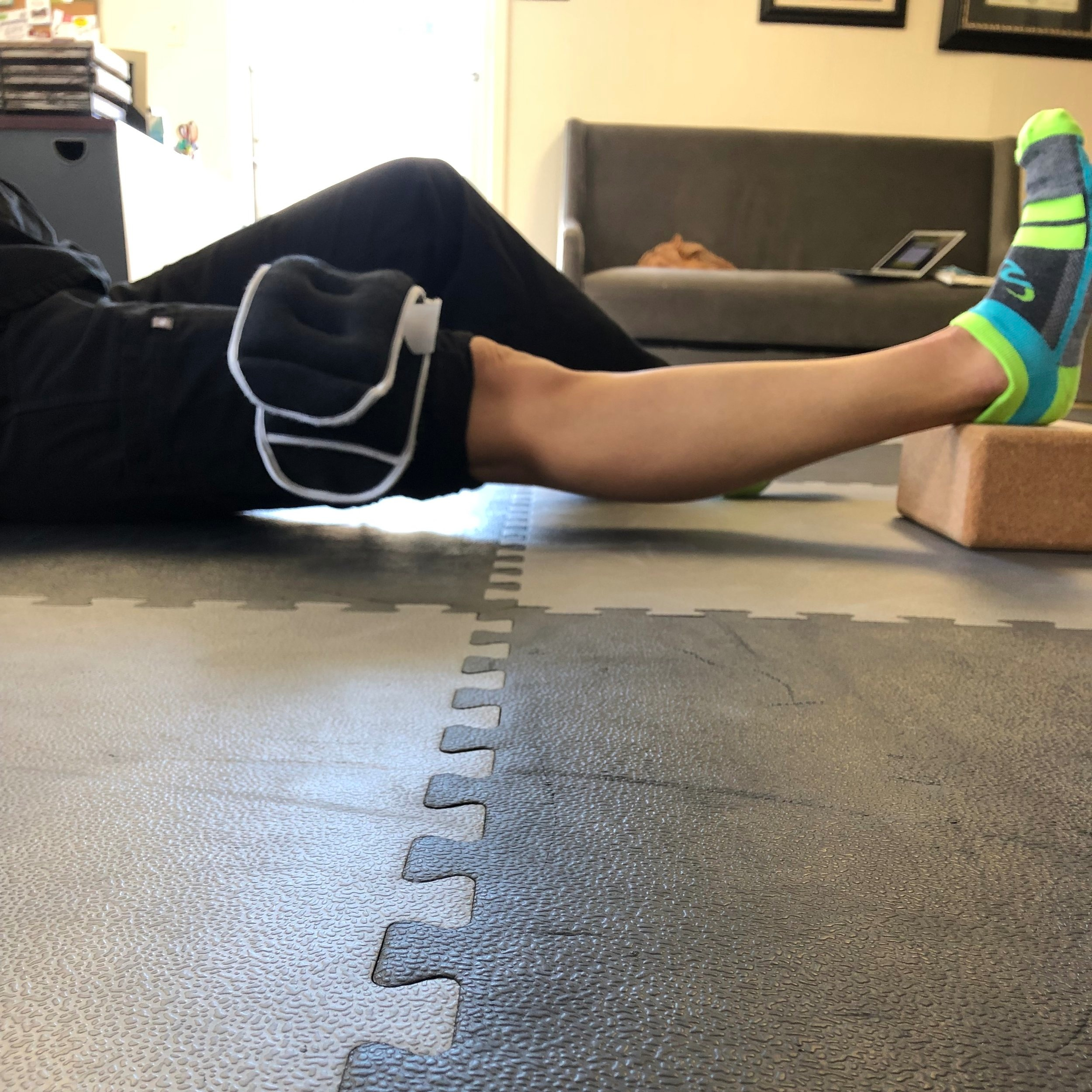 Weighted Knee Extension Stretch
