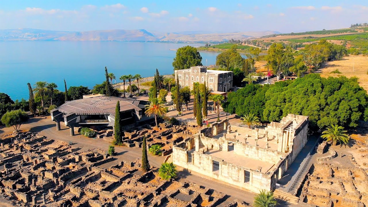 Ancient Capernaum drone footage with fifth century synagogue in white stone.