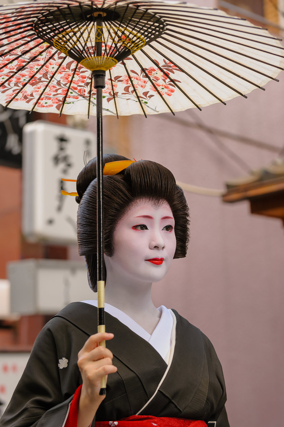 The geisha Mameharu of Gion Kobu with a sun parasol during Hassaku, an event held every August 1 in Kyoto